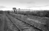 The disused line to the British Aluminium Company, Falkirk, with the works dominating the view on 20 March 1992. The last of the buildings alongside David's Loan was demolished in autumn 2006. An ASDA distribution depot now occupies much of the site.<br><br>[Bill Roberton&nbsp;20/03/1992]
