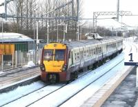 View west from the footbridge at Bathgate station on 14 December 2010 as the 13.47 to Helensburgh Central pulls away from platform 2.<br><br>[John Furnevel&nbsp;14/12/2010]