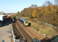 A First TransPennine service to Manchester Airport passes the site of Rylands crossing in Chorley in November 2011. When this was a foot crossing it was the scene of several near misses. The crossing has now been replaced by a footbridge and provides an ideal spot for photography.<br><br>[John McIntyre&nbsp;06/11/2011]