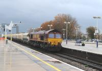 66108 runs through Didcot with a westbound freight on a wet and overcast 3 November 2011.<br><br>[Peter Todd 03/11/2011]