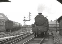 Black 5 no 45457 off Ardrossan shed, photographed from the foot of Ardrossan Harbour Junction signal box on 29 December 1962 [see image 8170]. Winton Pier is approximately 100 yards behind the camera and the line off to the left leads to Ardrossan North.<br><br>[R Sillitto/A Renfrew Collection (Courtesy Bruce McCartney)&nbsp;29/12/1962]