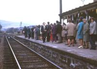 <I>Here comes the train... and only 13 years late!</I> An expectant crowd spots the class 24-hauled service from Inverness as it approaches Alness for the official reopening ceremony on 7 May 1973. The station had closed in 1960 when pre-Beeching cuts eliminated a swathe of wayside stations on the Far North line.<br><br>[David Spaven&nbsp;07/05/1973]