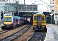 A First TransPennine class 170 unit bound for Hull arrives at Leeds on 4 November 2011, while a Northern service to Sheffield waits in the bay platform on the right, formed by a two car Class 158 unit.<br><br>[John McIntyre&nbsp;04/11/2011]