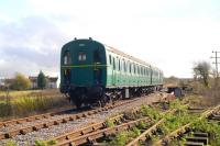 Preserved <I>'Thumper'</I> DEMU no 1302 approaching Blunsdon Station on the Swindon and Cricklade Railway on 12 November 2011.<br><br>[Peter Todd&nbsp;12/11/2011]