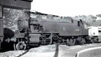 Ivatt 2-6-2T no 41230 stands alongside the turntable at Bangor shed, thought to have been taken in the late 1950s.<br><br>[K A Gray&nbsp;//]
