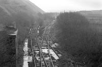 The branch line from Drumshoreland Junction at the former Pumpherston Oilworks in January 1978. Looking south east towards Camps Viaduct [see image 21914].<br><br>[Bill Roberton&nbsp;/01/1978]