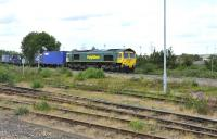 Freightliner 66538 eastbound off the Oxford curve through Didcot with a container train on 16 June 2011<br><br>[Peter Todd 16/06/2011]