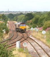 66154 crosses from down to up lines at Niddrie West on 29 July 2011 before heading for Portobello as part of a turning manoeuvre on the Millerhill / Niddrie West / Portobello / Millerhill triangle.<br><br>[John Furnevel&nbsp;/07/2011]