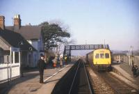 A southbound DMU, bound for Machynlleth, stands at Harlech in 1986.<br><br>[Ian Dinmore&nbsp;/03/1986]
