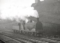 A J36 0-6-0, heads north past Castlehill Junction Ardrossan in November 1962. The locomotive is thought to be no 65273, allocated to 67D from March 1962 until withdrawal in September 1963. Ardrossan Town station is off picture to the left [see image 29400]. [With thanks to all who responded to this query].<br><br>[R Sillitto/A Renfrew Collection (Courtesy Bruce McCartney)&nbsp;/11/1962]