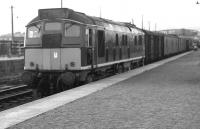 A train recently arrived from Kyle behind a type 2 stands at Dingwall in 1963.<br><br>[Colin Miller&nbsp;//1963]