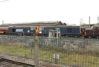 The last two stored Class 20s were towed away from Carnforth on 15 November 2011 to Barrow Hill. 20311 and 20314 were purchased by Harry Needle from DRS for further main line work. They were at Carnforth for many months and are pictured on the storage line there on 24 October 2011. Note the two different DRS blue liveries. 20314 and 20311 subsequently re-emerged from the workshops in HNRC orange livery [See image 48833]. <br><br>[Mark Bartlett&nbsp;24/10/2011]