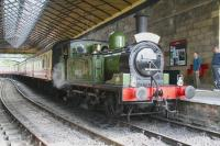 Veteran J72 0-6-0T no 69023 stands with a train under the overall roof at Pickering station on 30 June 2011. <br><br>[John Furnevel&nbsp;30/06/2011]