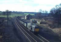 Eastbound coal empties run through the site of Curriehill station behind a Clayton on 13th February 1965. The original station here closed in 1951 but has since been replaced by a second, opened in October 1987. [See image 6939] <br><br>[Frank Spaven Collection (Courtesy David Spaven)&nbsp;13/02/1965]