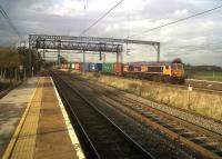 GB Railfreight 66734 thunders South on the WCML through Polesworth, Warwickshire, with a colourful container train on 4th November 2011. <br><br>[Ken Strachan&nbsp;04/11/2011]