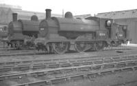Aspinall ex-LYR Class 23 no 11304 is one of the departmental 0-6-0STs used within Horwich Works, seen here with several contemporaries in the works yard in September 1960.<br><br>[K A Gray&nbsp;25/09/1960]