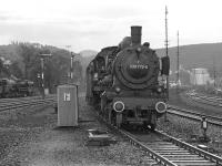 The DB's last operational class 038 4-6-0, No. 038 772, approaches Rottweil station in September 1974 with the 06.47 stopping train from Tuttlingen, some 17 miles to the south. On the left a class 50 2-10-0 is standing at the south end of the shed yard.<br><br>[Bill Jamieson&nbsp;04/09/1974]