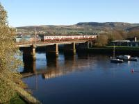 View north east from the 'new' road bridge over the River Leven at Dumbarton on 22 November 2011 as a westbound Class 320 crosses the river on the approach to Dalreoch station.<br><br>[John McIntyre&nbsp;22/11/2011]