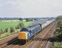 40077 with a northbound ECML train passing Shipton, North Yorkshire, on 15 August 1980.<br><br>[Peter Todd&nbsp;15/08/1980]