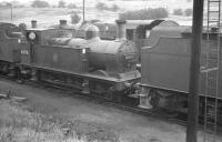 Johnson Midland 0-6-0T no 41875 photographed on Canklow shed in May 1961. The locomotive moved to Barrow Hill 3 months later and ended her operational days there in July 1963.<br><br>[K A Gray&nbsp;27/05/1961]