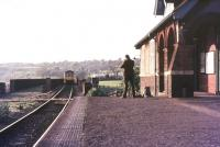 Platform view at Sea Mills on the Severn Beach branch in 1974 with an approaching DMU for Temple Meads crossing the bridge over the River Trym [see image 22225].<br><br>[Ian Dinmore&nbsp;//1974]