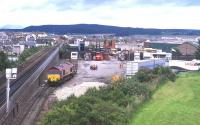 A Class 66 shunts Safeway traffic in the former coal yard at Inverness in 1999. The siding which formerly ran through to the harbour is on the extreme left. [See image 16325]<br><br>[David Spaven&nbsp;//1999]