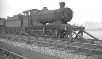 Withdrawn from Machynlleth the previous month, Collett 0-6-0 no 2233 is 'stored' pending disposal alongside Oswestry shed in October 1961.<br><br>[K A Gray&nbsp;02/10/1961]