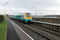 A short working from the junction to Llandudno for 175105, seen here leaving Deganwy  but it will return immediately as a through service to Manchester Piccadilly. To the right of the train, across the estuary, Conwy Castle and bridges can be seen.<br><br>[Mark Bartlett&nbsp;29/11/2011]