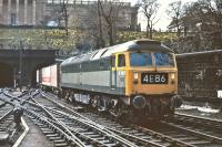 Although this particular day was a Saturday, the 11.50 Freightliner service from Aberdeen to Kings Cross, depicted here behind Brush Type 4 No. D1997, was a regular working through Waverley station on most days. The train ran 'Fridays excepted', presumably because the main traffic was perishables for the London markets, and the Saturday working was particularly interesting in that it recessed for almost 24 hours at Gosforth (can anyone explain why <br> there?) before continuing on its way to London at 16.50 on the Sunday afternoon.<br><br>[Bill Jamieson&nbsp;25/04/1970]