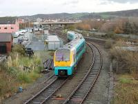 The 1450hrs Llandudno to Manchester service, formed by ATW 175105, leaves the branch at Llandudno Junction heading east. The tracks on the right are for Bangor and Holyhead with the large junction signal box on the left and the station beyond.<br><br>[Mark Bartlett&nbsp;29/11/2011]