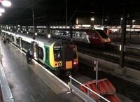 Evening departures from Euston on 11 November 2011. The 350 on the left is the 17.46 to Birmingham New Street.<br><br>[Ken Strachan&nbsp;11/11/2011]