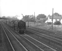 70014 <I>'Iron Duke'</I> is about to run through Beattock station with a southbound parcels train in the 1960s. The Moffat branch line is to the right. <br><br>[K A Gray&nbsp;//]
