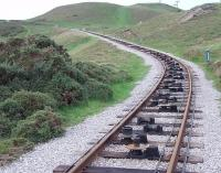 <I>Something missing?</I>. Winter on the upper section of the Great Orme Tramway and the tramcars are stored away and the looped haulage cable (one side for each car) has been removed. The cable rollers can clearly be seen in this view from the level crossing towards the summit. The vertical ones keep the cables between the rails on the curve.<br><br>[Mark Bartlett&nbsp;30/11/2011]