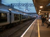 Patience is a virtue - a 12-car assembly of 350's forming a commuter service to London Euston awaits the off at Milton Keynes Central.<br><br>[Ken Strachan&nbsp;11/11/2011]