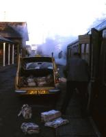The photographer takes a break from his job as Senior Railman at Tain in 1974 to capture this early morning scene showing newspapers being offloaded from the 06.15 Inverness-Wick/Thurso train.<br><br>[David Spaven&nbsp;//1974]
