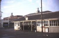 Waiting for the Gravesend Ferry at Tilbury Riverside in December 1984. The station clock stands on the horizon right of centre with the Port of London Authority building to the left. The terminus lost its passenger service in November 1992 and the station is now used as an arts centre and car park. Connection with the ferry is now provided by a shuttle bus service from Tilbury Town station. [See image 37969] <br><br>[Ian Dinmore&nbsp;/12/1984]