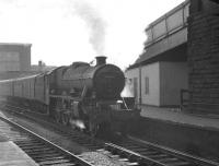 The north end of Carlisle station on 12 April 1963 sees Jubilee 45560 <I>'Prince Edward Island'</I> preparing to leave platform 3 and head north with the 9.15am Manchester - Glasgow Central.<br><br>[K A Gray&nbsp;12/04/1963]