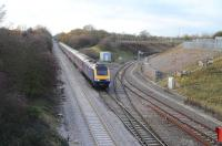 Looking west from the road bridge adjacent to the branch into the Keypoint Railfreight terminal/interchange on the east side of Swindon as a First Great Western HST passes by en route to Paddington. <br><br>[Peter Todd&nbsp;06/12/2011]