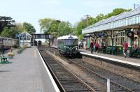 A preserved Waggon & Maschinenbau railbus waits patiently, in a (fairly) timeless scene, at Sheringham station on a sunny 6th May 2011.<br><br>[Brian Taylor&nbsp;06/05/2011]