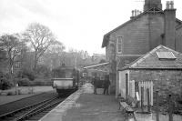 A railbus stands at the platform at Dalmellington on 3 November 1962 with a service for Kilmarnock. The vehicle is thought to be AC cars unit SC 79979 which ended its days as a grounded bodyshell on the Strathspey Railway at Aviemore before being scrapped [see image 36743].<br><br>[R Sillitto/A Renfrew Collection (Courtesy Bruce McCartney)&nbsp;03/11/1962]