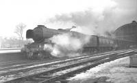 A3 no 60039 <I>Sandwich</I> with an up ECML express about to depart from Darlington on a winter's day in 1962.<br><br>[K A Gray&nbsp;//1962]