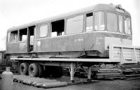 The body of withdrawn AC Cars railbus SC 79979 stands on a road trailer in a Coatbridge scrapyard in October 1977 awaiting removal to the Strathspey Railway [see image 16258].<br><br>[Bill Roberton&nbsp;/10/1977]