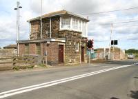 The ECML level crossing and signal box at Chathill, Northumberland, photographed looking east towards the coast in August 2007. [See image 21832] <br><br>[John Furnevel&nbsp;16/08/2007]