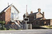 The former station at Cowbit on the Spalding - March line, seen from the level crossing in 1977. The station closed to passengers in 1961.<br><br>[Ian Dinmore&nbsp;//1977]
