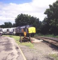 A class 37 with Moorswater - Par clay hoppers at Liskeard in August 1991.<br><br>[Ian Dinmore&nbsp;/08/1991]