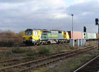 Freightliner 70007 turns north through Didcot with a container train from Southampton on 15 December.<br><br>[Peter Todd 15/12/2011]