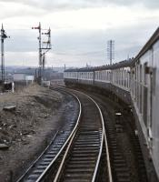 Looking back along the train as it passes through the partly demolished Bathgate Upper Station on 7 March 1971 [see image 36926]. The junction for Bathgate Lower can be seen immediately beyond the trailing driving car.<br><br>[Bill Jamieson&nbsp;07/03/1971]
