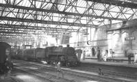 Standard Class 4 2-6-0 no 76049 brings the late running 9.50am Edinburgh Waverley - Leeds City into Carlisle on 7 August 1965. The locomotive had taken over the train at Hawick, following removal of St Margarets V2 no 60970, with an injector fault.<br><br>[K A Gray&nbsp;07/08/1965]