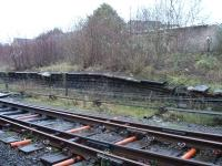 Remains of the north end of the redundant northbound platform at Tondu, which once handled services coming off the line from Margam. Two complete, but now disconnected, sidings remain in situ amongst the undergrowth behind the platform. [See image 18266]<br><br>[David Pesterfield&nbsp;22/12/2011]