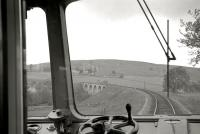 View west from a train showing Balnacraig Viaduct on the former Royal Deeside line in the summer of 1962. The 1857 structure, which spanned  the Beltie Burn just west of Torphins, Aberdeenshire, was also referred to as Sundayswells, Lumphanan and Beltie Burn Viaduct. Demolition was carried out in June 1989.<br><br>[R Sillitto/A Renfrew Collection (Courtesy Bruce McCartney)&nbsp;07/07/1962]